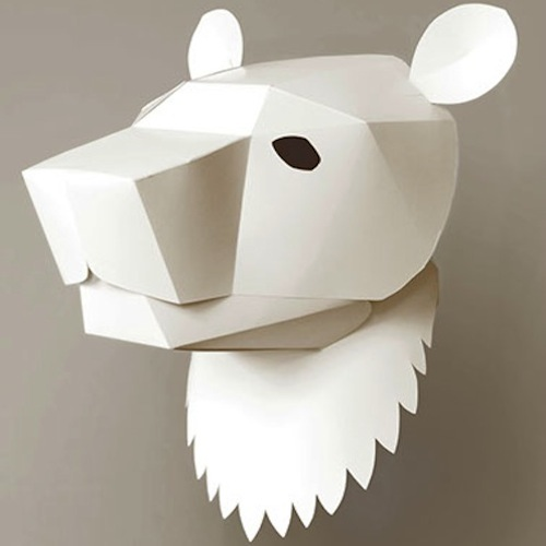 """Maska"" is a paper folding product from Sorochelab that creates a 3D head by folding, gluing and assembling a flat paper shape. They can be placed on a wall like art or decoration, but also they are wearable as mask for a costume or just for fun. They come in blank and they can be painted or customized if wanted."