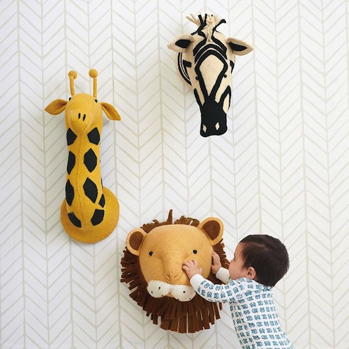 Create a fun wall of the wild and let imagination roam. A bamboo frame gives shape to animals crafted from colorful felted wool via Serena and Billy.